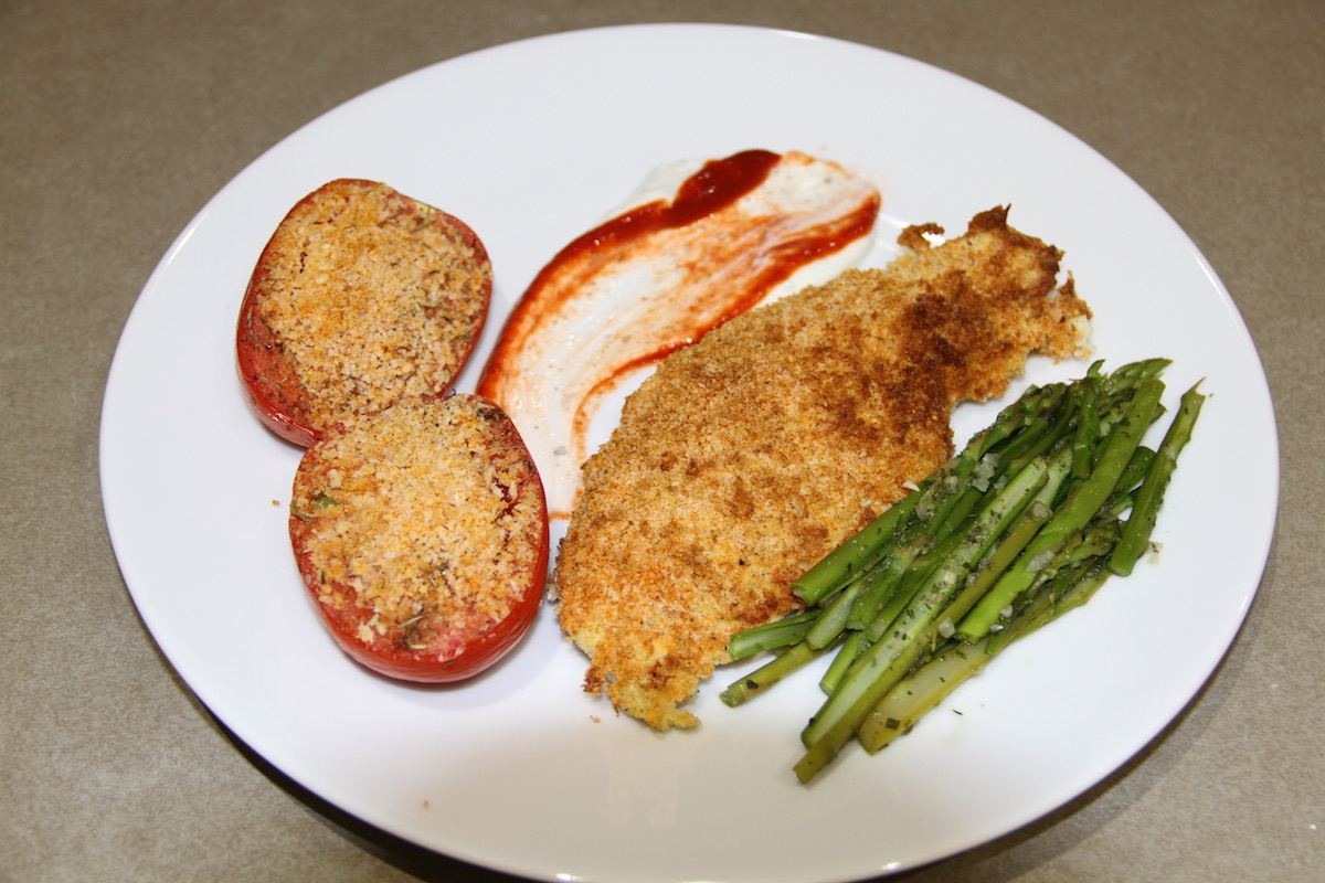 Plated Air Fryer Potato Crusted Fish Filets with Baked Tomatoes and Asparagus