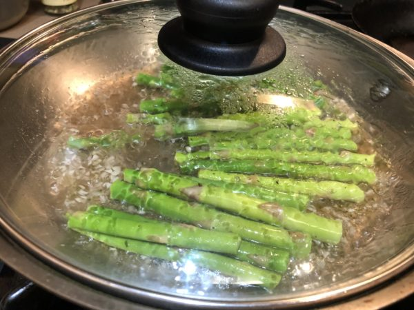 Poaching Asparagus Spears in white wine.