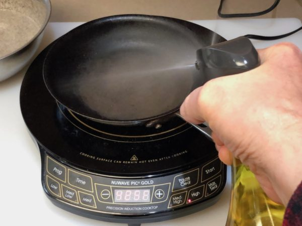 Spray the skillet with oil.