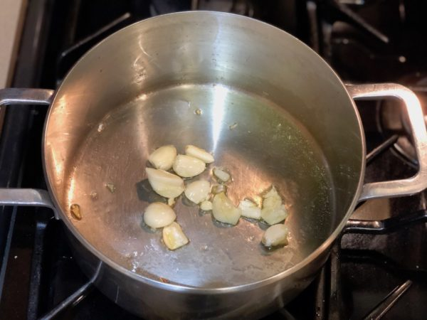 Sauté garlic cloves with olive oil in sauce pan