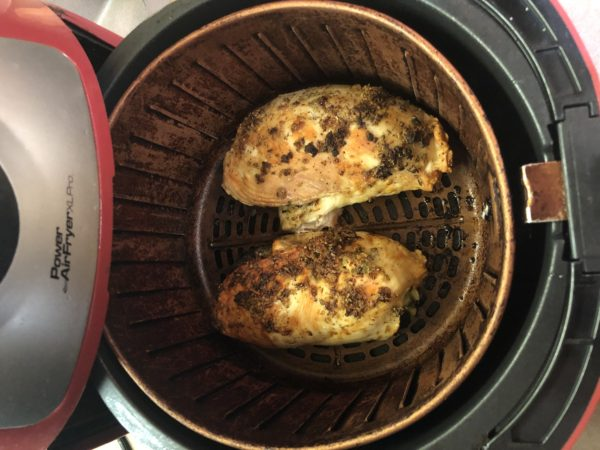 Air Fried Spinach Stuffed Chicken Breast coming out of Air Fryer. See that wonderful golden brown color, that's still in the Air Fryer basket.