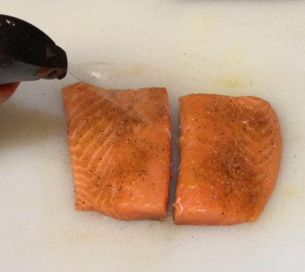 Spray Salmon Filets with olive oil using the EVO Sprayer